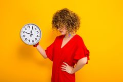 Attractive Woman With Short Curly Hair With Clocks Royalty Free Stock Photos