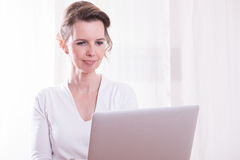 Attractive woman woman working with computer on her hands Royalty Free Stock Photo