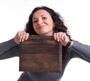 Attractive woman with wooden panel Royalty Free Stock Photo