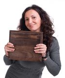 Attractive woman with wooden panel Stock Photo