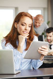 Attractive woman at work Royalty Free Stock Photography