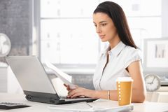 Attractive woman at work royalty free stock photo