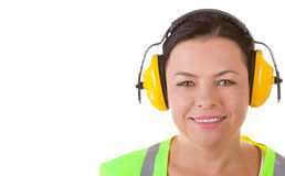 Attractive Woman Worker in Safety Jacket and Protective Ear Head. Phones with Copyspace for Yours Design on a white background stock images