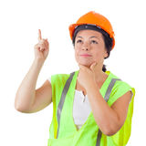 Attractive Woman Worker in Safety Jacket and Yellow Helmet get a Stock Photo