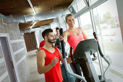 Attractive woman working cardio exercises with trainer Stock Photography