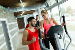 Attractive woman working cardio exercises with trainer Stock Photos