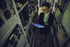 Woman in data centre Stock Image