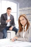 Attractive woman working at desk smiling royalty free stock photos