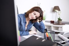 Attractive woman working hard at the office Stock Images