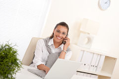 Attractive woman working with laptop Royalty Free Stock Images