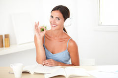 Attractive woman working while listening to music Royalty Free Stock Image