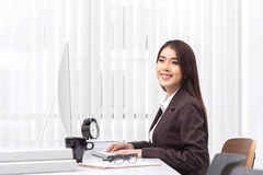Attractive woman working in office on computer Royalty Free Stock Photos
