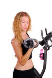Attractive woman working out with a dumb bell Stock Image