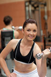 Attractive woman working out with dumbbells Stock Image