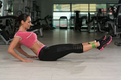 Attractive Woman Working Out With Rubber In Gym Stock Photo