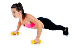 Attractive woman working on push ups isolated Royalty Free Stock Photos