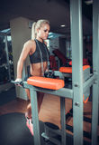 Attractive woman on workout machine Stock Photos