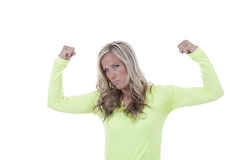 Attractive woman in workout top flexing looking at camera Royalty Free Stock Photo