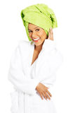 Attractive woman wrapped in towel with turban. Stock Photos