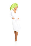 Attractive woman wrapped in towel with turban. Isolated on white Royalty Free Stock Image
