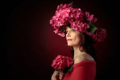 Attractive woman in wreath with coral hydrangea blossoms stock image