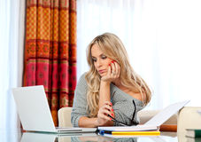 Attractive woman writing on laptop Royalty Free Stock Photography