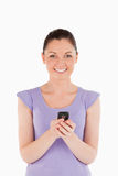 Attractive woman writing a text Stock Photos