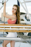 An attractive woman on a yacht on a summer day. Cruise, travel, Royalty Free Stock Images