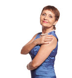 Attractive woman 50 years in blue dress Stock Image