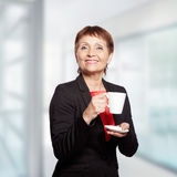 Attractive woman 50 years. With cup of  coffee Stock Photos