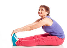 Attractive woman 50 years doing fitness Stock Photo