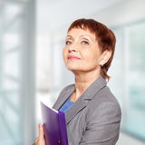 Attractive woman 50 years old. With a folder for documents Royalty Free Stock Photography