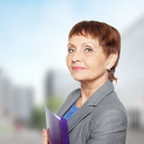 Attractive woman 50 years old. With a folder for documents Royalty Free Stock Image