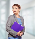 Attractive woman 50 years old. With a folder for documents Stock Images
