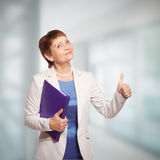 Attractive woman 50 years old. With a folder for documents Stock Image