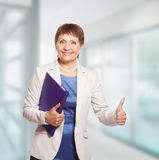 Attractive woman 50 years old. With a folder for documents Stock Photos