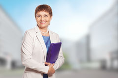 Attractive woman 50 years old with a folder. For documents Stock Photo