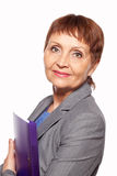 Attractive woman 50 years old with a folder for documents. On white background Royalty Free Stock Photography