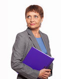 Attractive woman 50 years old with a folder for documents. On white background Stock Photography