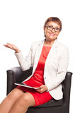 Attractive woman 50 years old with a tablet computer Royalty Free Stock Photos