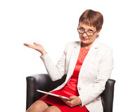 Attractive woman 50 years old with a tablet computer Royalty Free Stock Photo