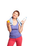 Attractive woman 50 years with an orange and a bottle of water Stock Photos
