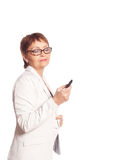 Attractive woman 50 years speaks by mobile phone Royalty Free Stock Images
