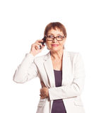 Attractive woman 50 years speaks by mobile phone Stock Images