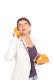 Attractive woman 50 years with vintage telephone Stock Photography