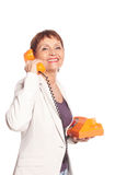 Attractive woman 50 years with vintage telephone Royalty Free Stock Photography