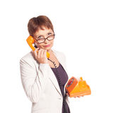 Attractive woman 50 years with vintage telephone Stock Photos