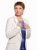 Attractive woman 50 years in a white jacket Royalty Free Stock Image