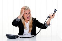Attractive Woman Yelling at the Telephone Stock Image