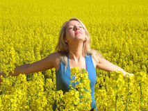 Attractive woman in yellow. Photo of attractive woman in yellow flowers Royalty Free Stock Photos